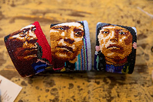 Beaded bracelets depict Native American portraits.
